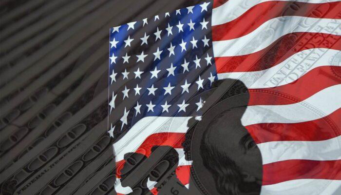 USA riigivõlg - Ameerika Ühendriikide riigivõlg illustreeriv pilt, kus on kujutatud USA lippu ning 100-dollarit.